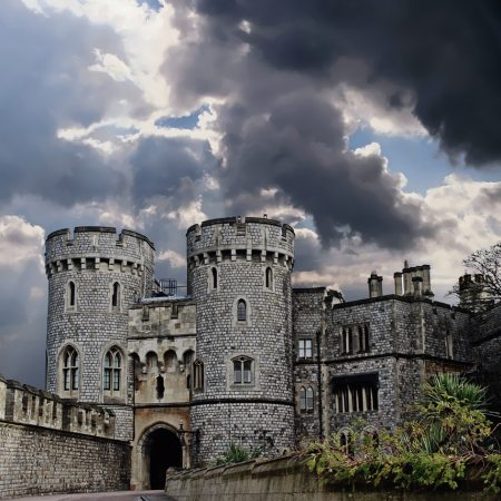 Grey stone castle against grey clouds