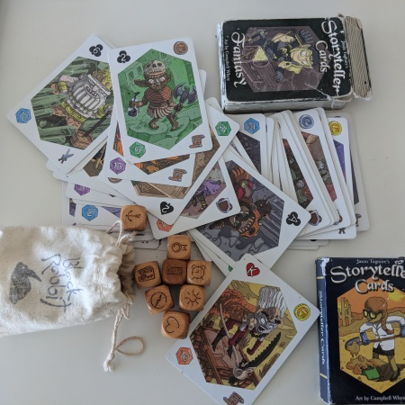 pile of storyteller cards and icon dice