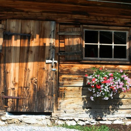 Wooden cottage front with window box
