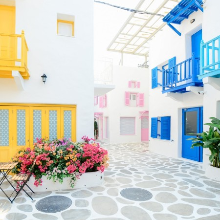 Fake street with white buildings and colourful balconies