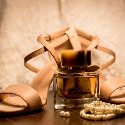 High heeled shoes, perfume bottle and pearls