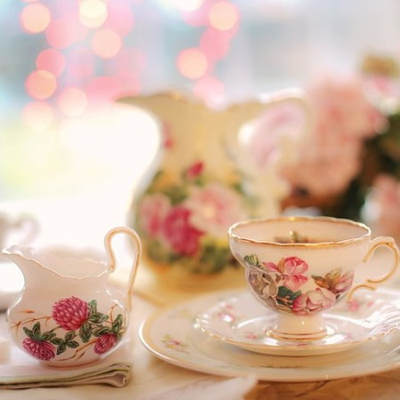 Ornate white teaset with pink floral decoration