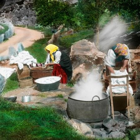 Women washing sheets outside
