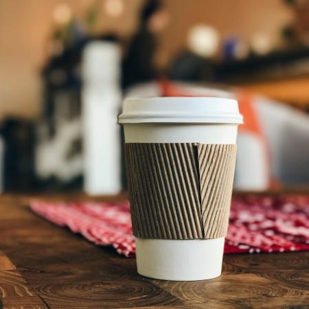 takeaway coffee cup by ross-varrette-ACrTnL4mDL4-unsplash