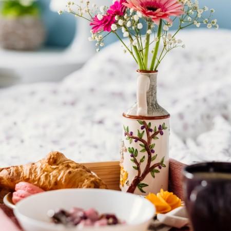 breakfast tray on a bed by freestocks-06AX05zvS2k-unsplash