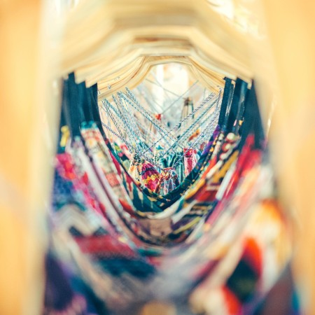 rack of dresses shot through the hangers by inspirationfeed-PsxNKud0ucg-unsplash