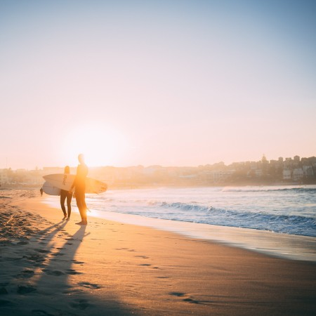 surfers on Bondi Beach at sunrise by alex-king-pzM4E7OhWLk-unsplash
