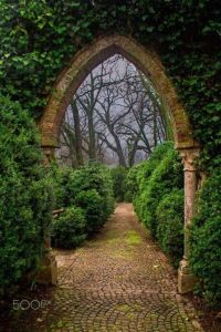 Stone and brick archway in garden